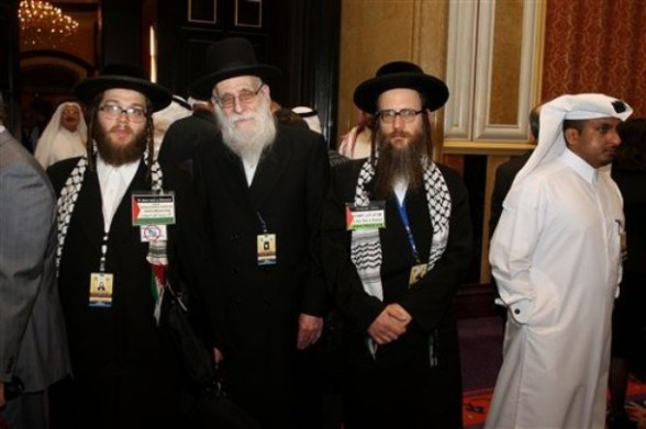 A delegation of the Neturei Karta, Orthodox Jews, arrive at the opening of the International Conference on Jerusalem in Doha, Sunday Feb. 26, 2012.   Qatar's ruler says the Arab identity in Jerusalem is threatened by Israeli expansion around the city claimed as capital by both Israel and Palestinians. Sheik Hamad bin Khalifa Al Thani urged a U.N-backed investigation into Israeli settlements as well as Israeli actions in predominantly Arab districts in Jerusalem and surrounding areas captured by the Jewish state in 1967.(AP Photo/Osama Faisal)