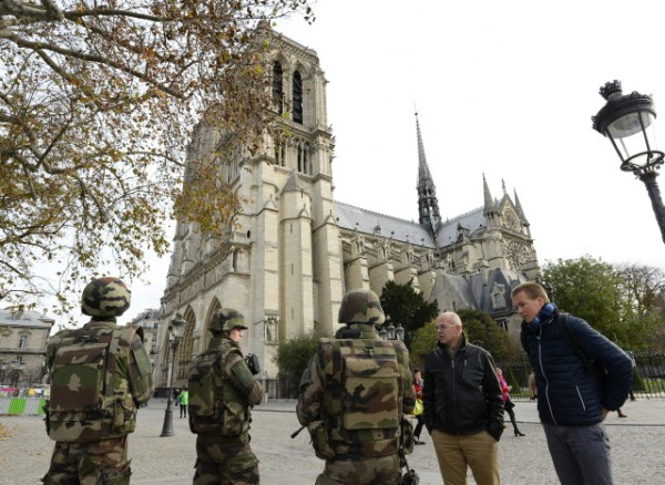 French soldiers patrol in front of Notre-Dame de Paris Cathedral in Paris on November 14, 2015, following a series of coordinated attacks in and around Paris late Friday which left more than 120 people dead. According to witnesses, at least 5 people were killed in the immediate area by attackers wielding automatic rifles.  AFP PHOTO / BERTRAND GUAY