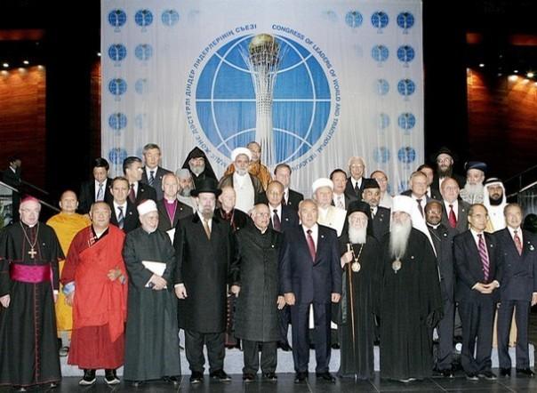 Kazakh President Nursultan Nazarbayev (C) and the participants of the II Congress of Leaders of World and Traditional religions pose for a family picture in Astana, 12 September 2006. A three-day forum on religious freedom and tolerance brings together more than 40 national delegations and as many international spiritual leaders in the capital of Kazakhstan. AFP PHOTO / STANISLAV FILIPPOV (Photo credit should read STANISLAV FILIPPOV/AFP/Getty Images)
